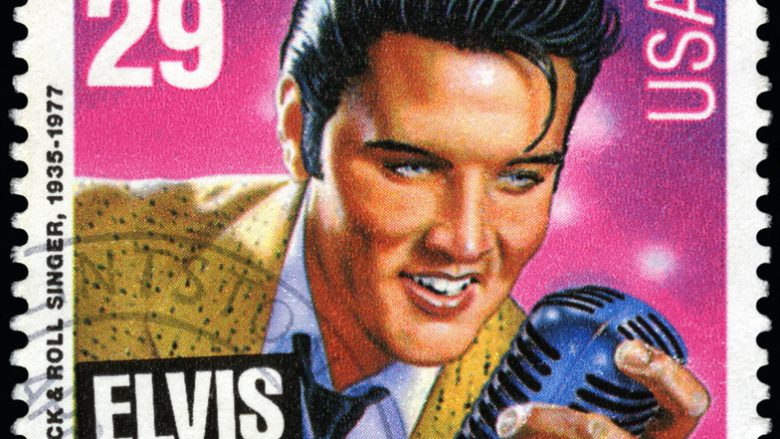 "Seattle, Washington, USA - January 03, 2012: A 1993 USA postage stamp with an illustration of Elvis Presley holding a microphone. The stamp illustraton of ""young Elvis"" is by Mark Stutzman."